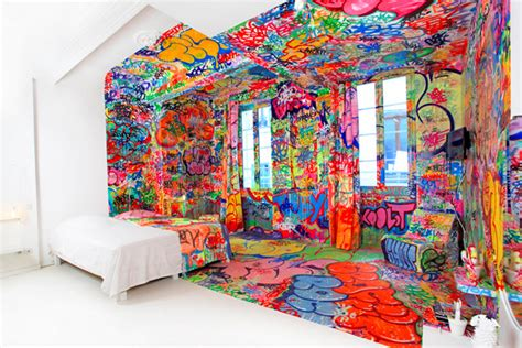 french hotel room  covered  graffiti colossal
