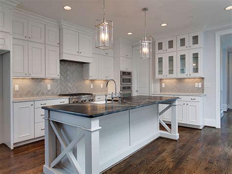 soapstone kitchen island white kitchen cabinets with gray chevron tile backsplash