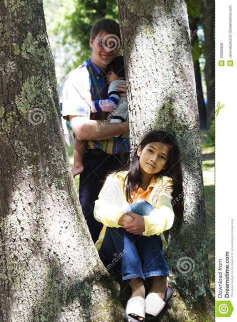 young girl sitting  tree royalty  stock image