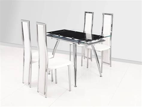 small black extending glass dining table and 4 white chairs