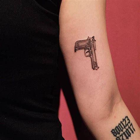 gun tattoo   left  arm tattoo artist