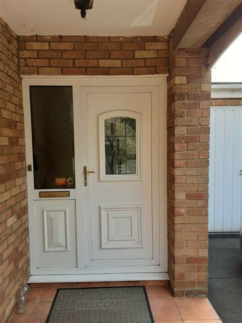 white upvc double glazed front door  side panel stained glass  frame  coventry west