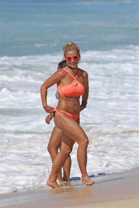 mgk swimsuit britney spears in neon peach bikini at beach in hawaii