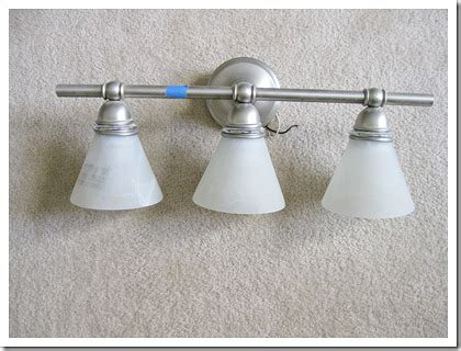 Changing Light Fixture In Bathroom by Changing The Bathroom Light Fixture Domestically Speaking