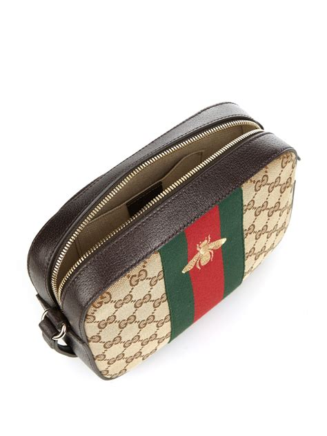 lyst gucci  gg canvas  leather cross body bag  brown