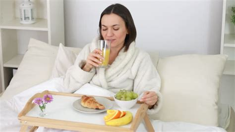 Attractive Happy Woman Eating Breakfast In Bed Stock