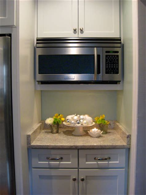 how wide is a microwave cabinet how to hide a microwave building it into a vented cabinet