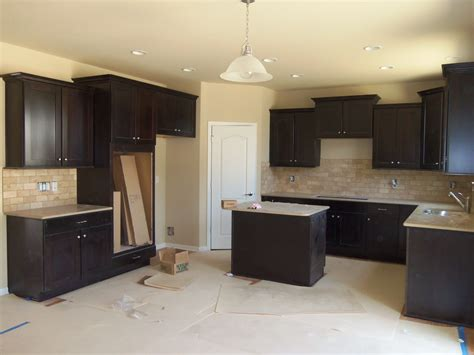 photos of kitchens with oak cabinets merillat tolani maple staggered cabinets in kona denova 9090