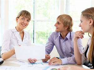 Young business people working together in office | Stock ...