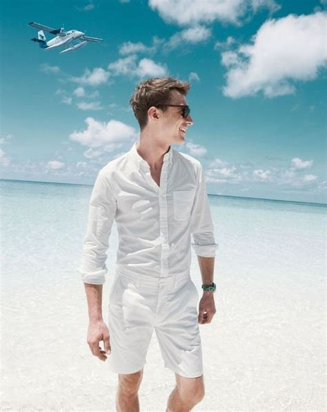 Picture Of beach all white look with a white shirt and shorts