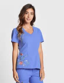 the embroidered top in ceil blue medical scrubs by jaanuu