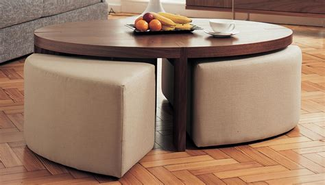 coffee table with ottoman seating underneath coffee