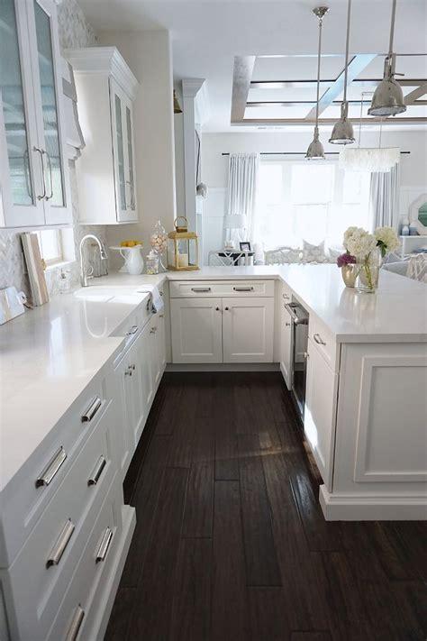 Kitchen Peninsula with white quartz countertop and dark