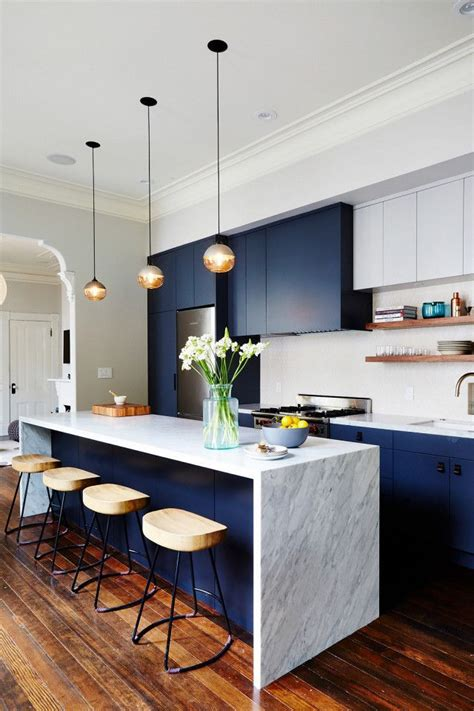 Modern Kitchen With Dark Blue Cabinents, A Marble Island