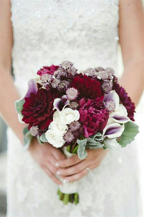 elegant bridal bouquet arranged  red violet dahlias