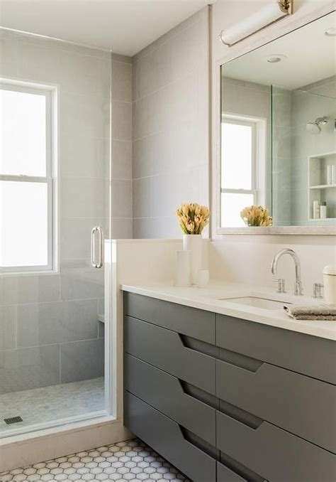 modern gray bathroom features an ivory full length mirror