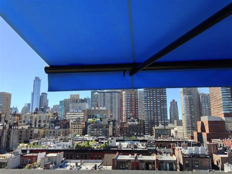 retractable awning  nyc penthouse  breslow home design wwwbreslowcom retractable awning