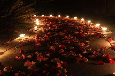 nighttime walkway  candles rose petals anniversary