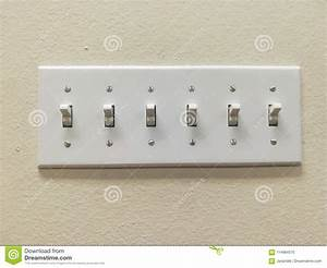 Multiple Light Switches Grouped Together Stock Photo