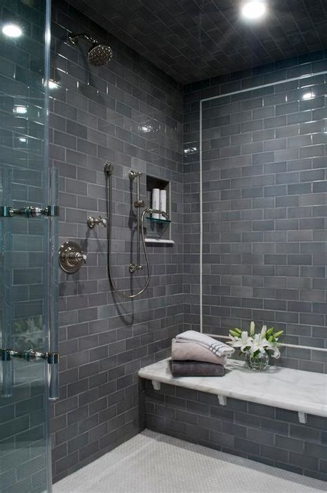 gray subway shower tiles  white marble top bench