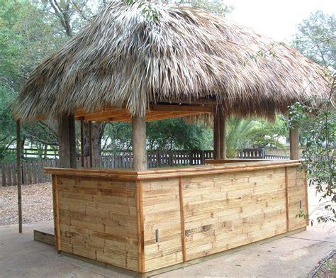 backyard tiki hut ideas palm thatch tiki hut concession stand with shutters and flattened bamboo bar ideas pinterest