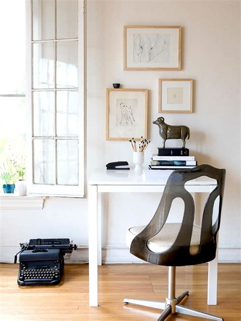 floor l in front of window chic typewriter on wooden floor under glass window side beautiful picture on cute frame front