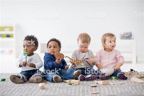 babies together in preschool stock photo amp more 352 | babies playing together in preschool picture id507632186