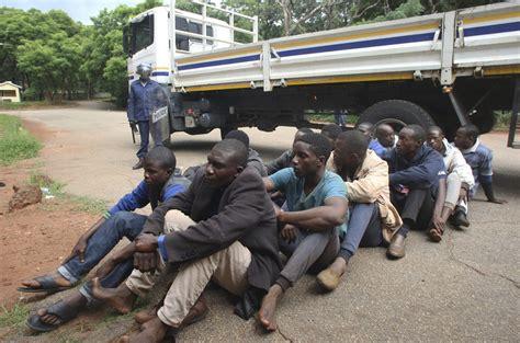 Zimbabwe police arrest 19 for breaching lockdown ...