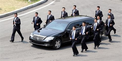 Kim Jong Un's bodyguards run beside his limo back into ...