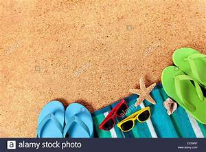 Summer beach background of towel, starfish, seashell, flip ...