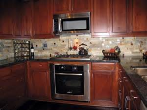 backsplash ideas for cherry cabinets and black granite