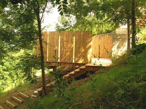 chambre suite parentale 4 terrasses posées sur un jardin en pente