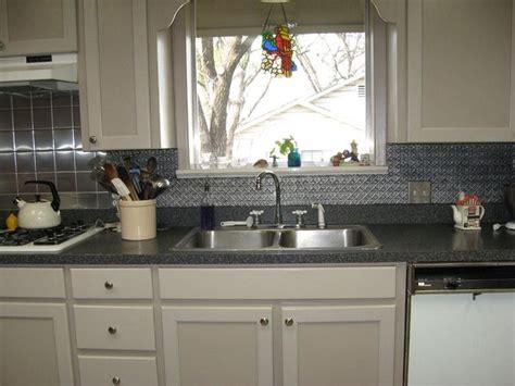 pin  susan tyson       kitchen tin tile