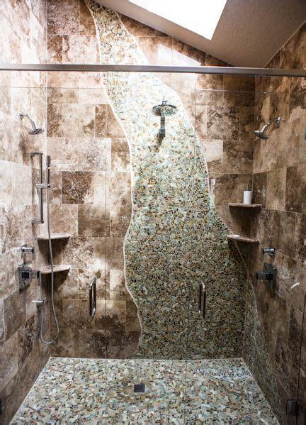creative tile shower  multiple shower heads rustic
