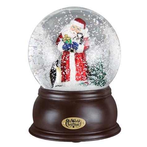 santa with penguin pals old world christmas snow globe 54004