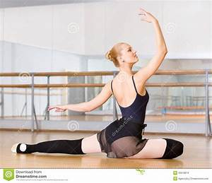 ballerina does exercises sitting on the floor stock photo With dance where you sit on the floor