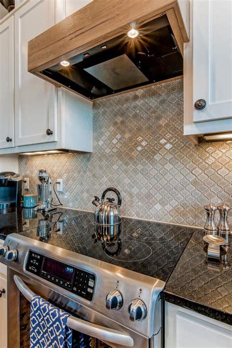 arabesque tile kitchen backsplash  wooden range hood hgtv