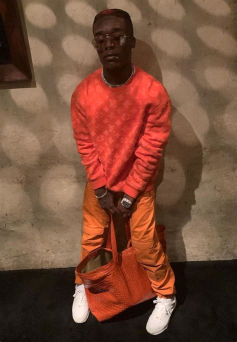 Lil Uzi Vert Shows Off Orange Fit   Incorporated Style
