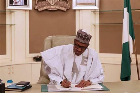 photo of president buhari as he resumes work in his office