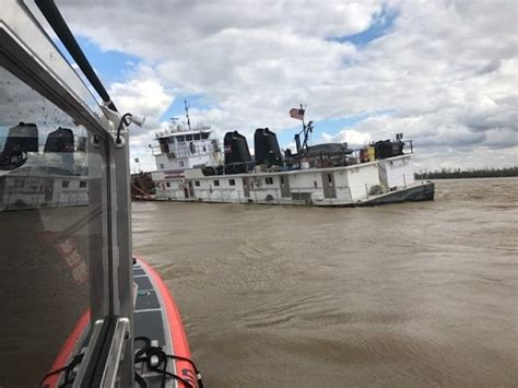 Tow Boat Sinks On Ohio River by Towing Vessel Pinned To Dam And Taking On Water On Ohio