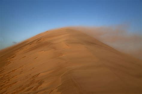 Sand Blowing Over The Top Of A Sand Dune  Khongoryn Els