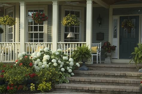 front porch garden front porch columns front porch columns traditional with dark wood trim resin statues and