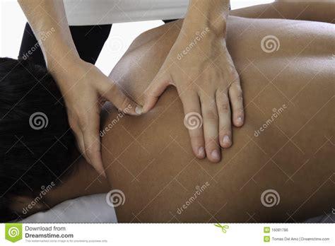 woman massaging  young man royalty  stock image