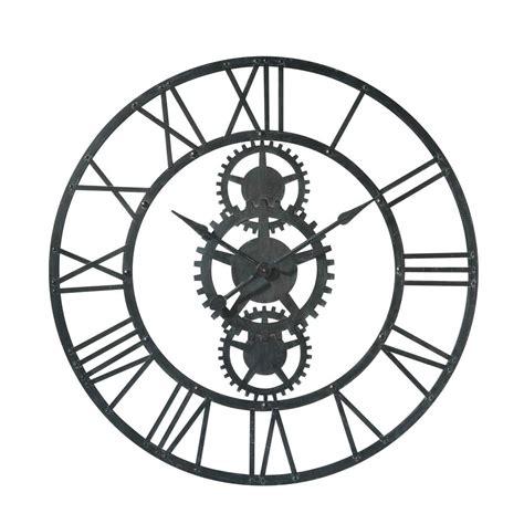 horloge en metal noire   cm temps modernes maisons du monde