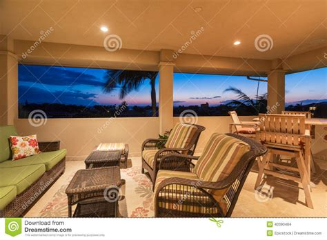 deck and patio furniture at sunset stock photo image