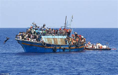 Overcrowded Refugee Boat migrants saved on mediterranean sea from overcrowded