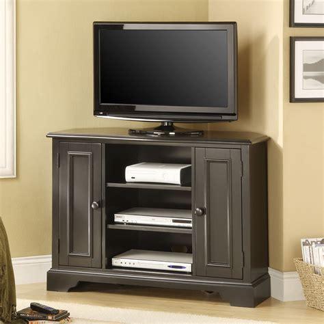 bedroom corner tv stand black melamine finished solid wood corner tv stand for bedroom placed on the beige wooden
