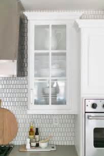 gray lacquered kitchen cabinets  white  silver oval iridescent mosaic tiles