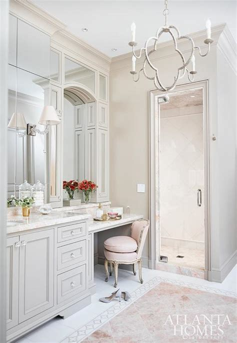pink and gray bathroom with pink marble tile floor