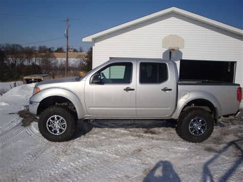 lifted silver nissan frontier gristle1 2009 nissan frontier crew cabse pickup 4d 5 ft